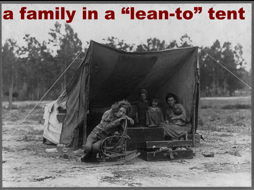 27 a family in a lean-to tent