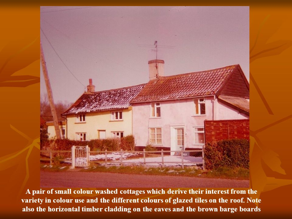 A pair of small colour washed cottages which derive their interest from the variety in colour use and the different colours of glazed tiles on the roof.