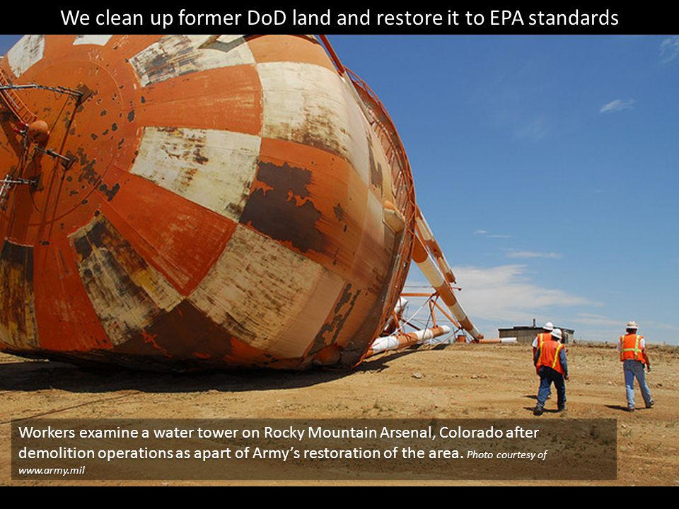 Workers examine a water tower on Rocky Mountain Arsenal, Colorado after demolition operations as apart of Army's restoration of the area.