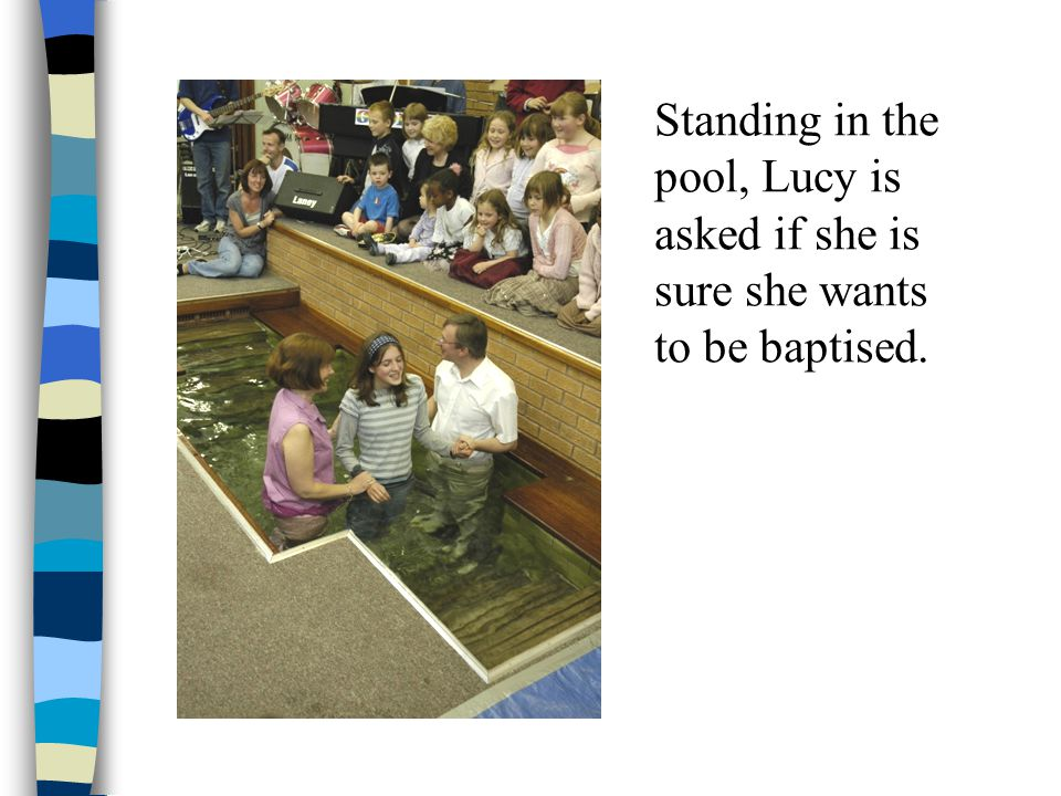 Standing in the pool, Lucy is asked if she is sure she wants to be baptised.