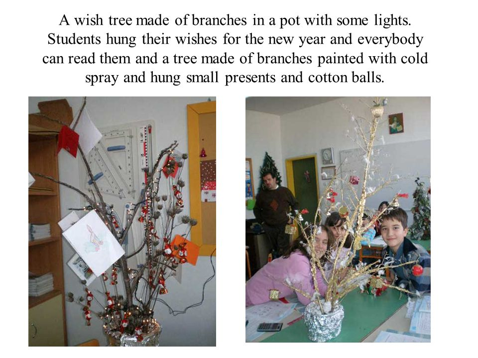 A wish tree made of branches in a pot with some lights.