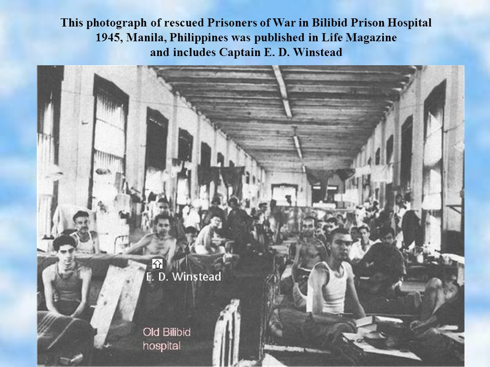 This photograph of rescued Prisoners of War in Bilibid Prison Hospital 1945, Manila, Philippines was published in Life Magazine and includes Captain E.