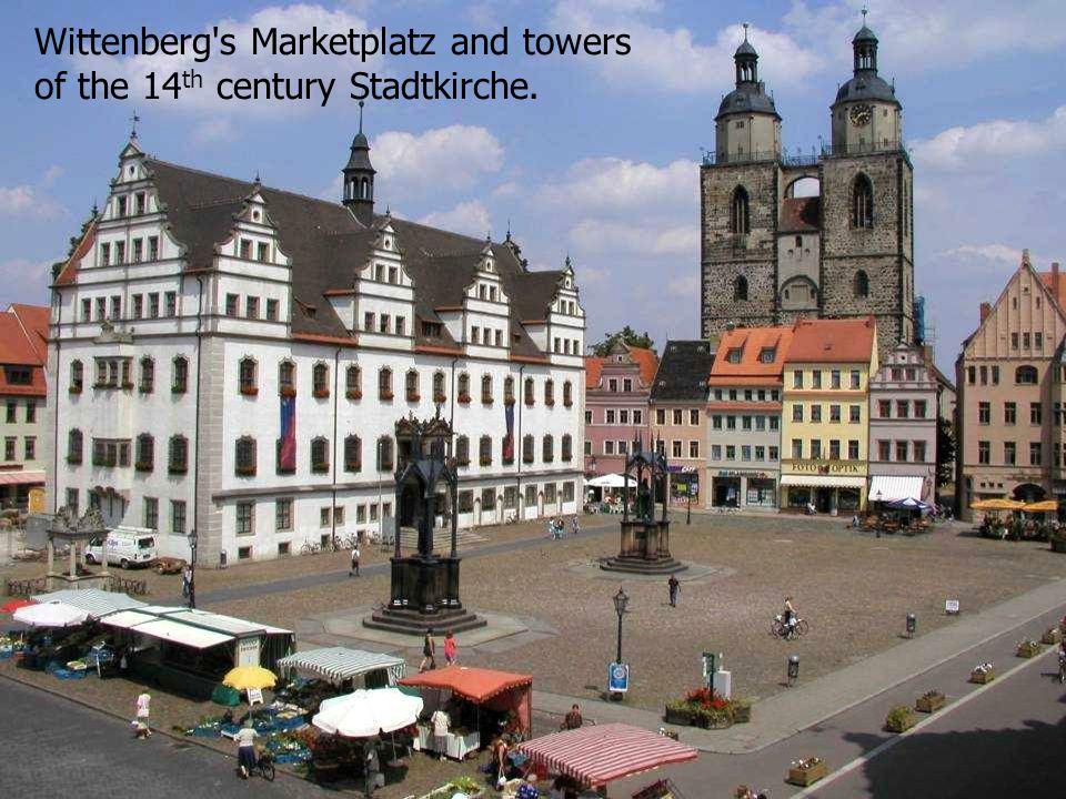 Wittenberg s Marketplatz and towers of the 14 th century Stadtkirche.