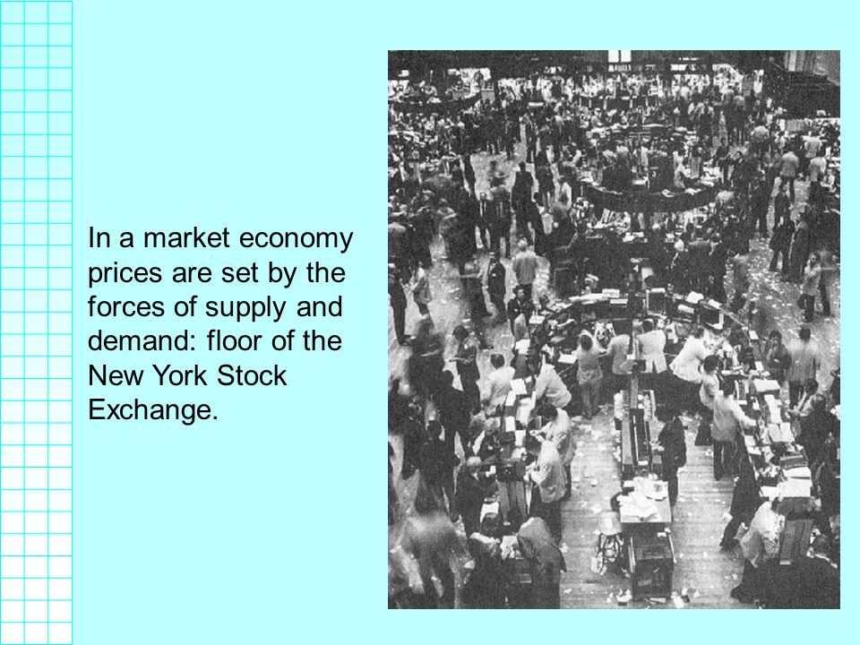 In a market economy prices are set by the forces of supply and demand: floor of the New York Stock Exchange.