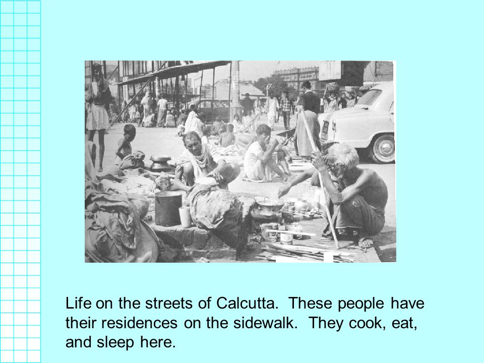 Life on the streets of Calcutta. These people have their residences on the sidewalk.