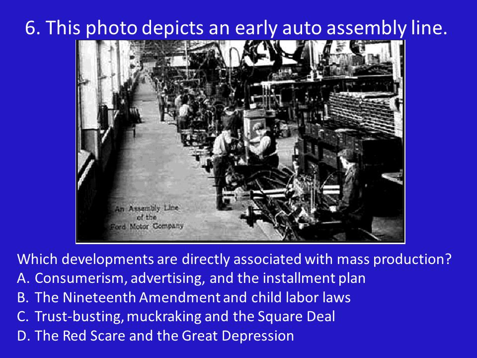 6. This photo depicts an early auto assembly line.
