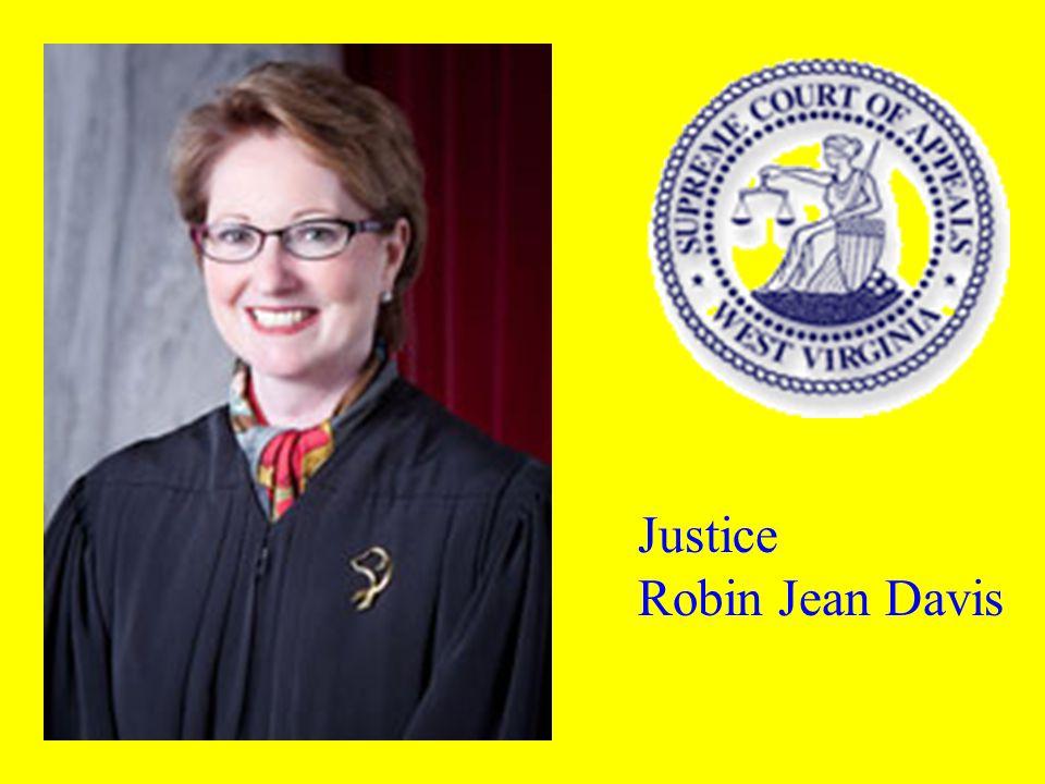 Justice Hon Menis E. Ketchum