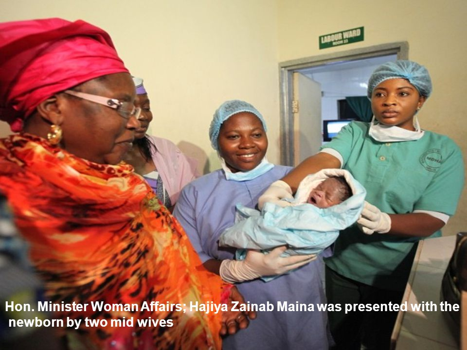 Hon. Minister Woman Affairs; Hajiya Zainab Maina was presented with the newborn by two mid wives