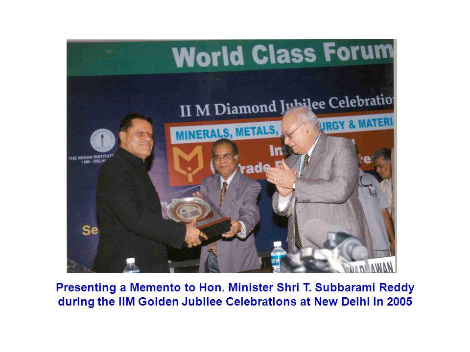 Presenting a Memento to Hon.Minister Shri T.