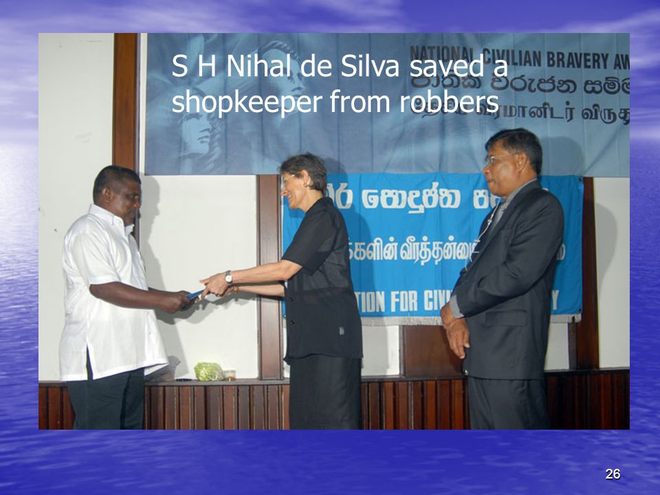 26 S H Nihal de Silva saved a shopkeeper from robbers