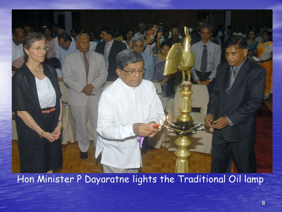 8 Hon Minister P Dayaratne lights the Traditional Oil lamp