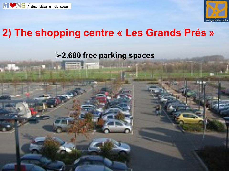 2) The shopping centre « Les Grands Prés »  free parking spaces