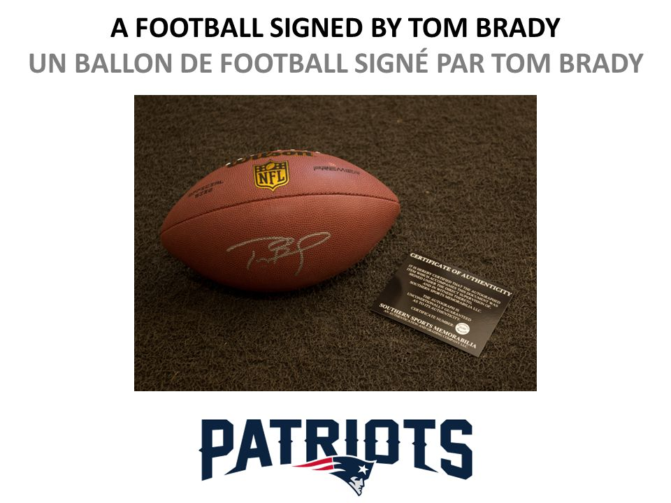 A FOOTBALL SIGNED BY TOM BRADY UN BALLON DE FOOTBALL SIGNÉ PAR TOM BRADY
