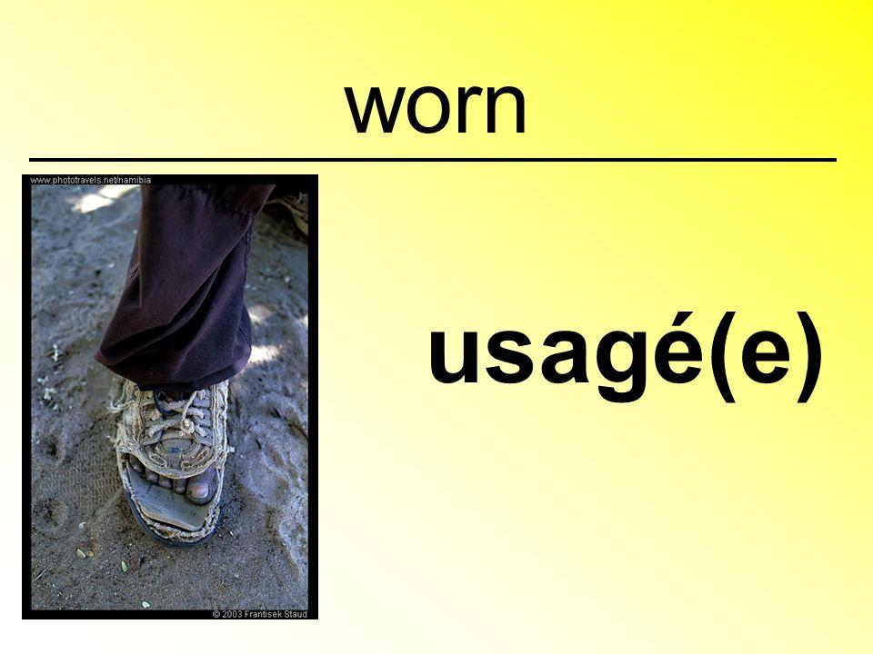 worn usagé(e)