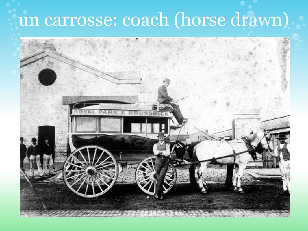 un carrosse: coach (horse drawn)