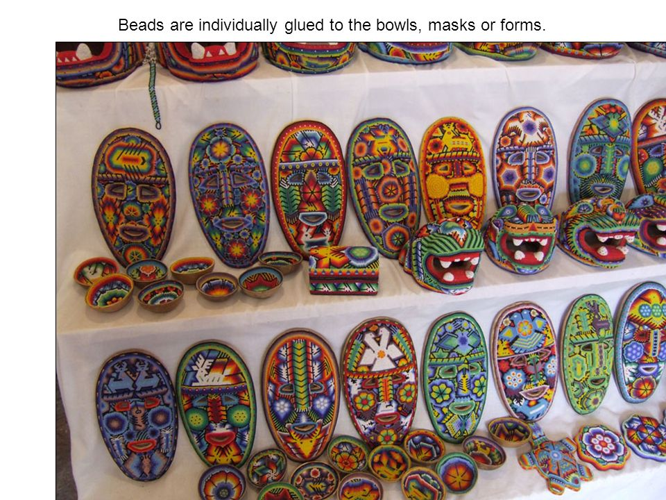 Beads are individually glued to the bowls, masks or forms.