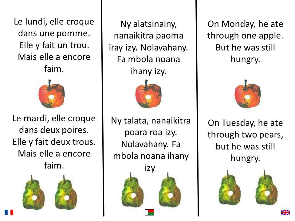 Le lundi, elle croque dans une pomme. Elle y fait un trou.