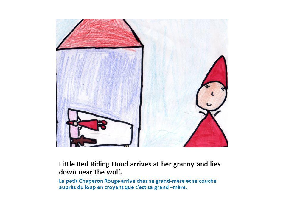 Little Red Riding Hood arrives at her granny and lies down near the wolf. Le petit Chaperon Rouge arrive chez sa grand-mère et se couche auprès du lou