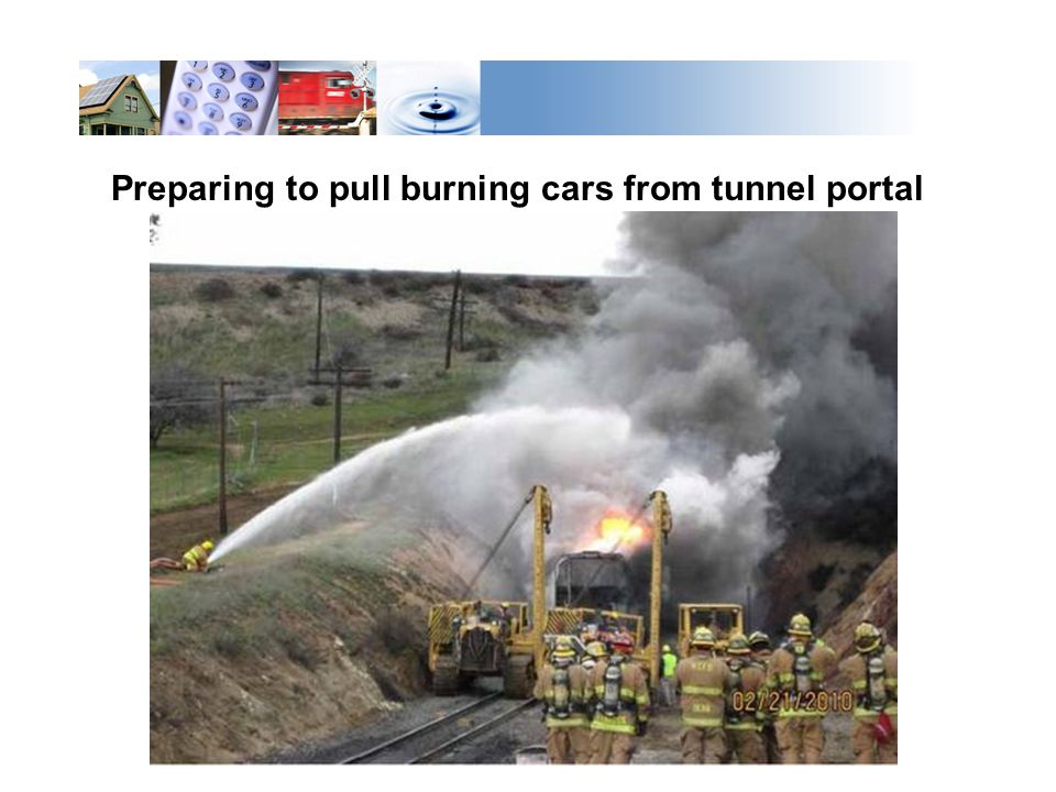 Preparing to pull burning cars from tunnel portal