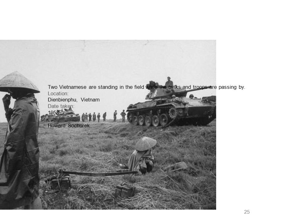 25 Two Vietnamese are standing in the field while the tanks and troops are passing by. Location: Dienbienphu, Vietnam Date taken: 1953 Photographer: H