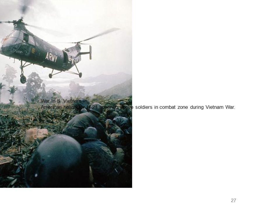 27 War In S. Vietnam American helicopter H-21 hovering above soldiers in combat zone during Vietnam War.