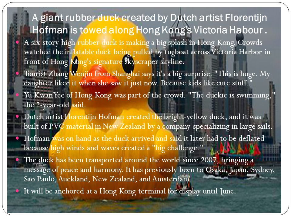 A giant rubber duck created by Dutch artist Florentijn Hofman is towed along Hong Kong s Victoria Habour.