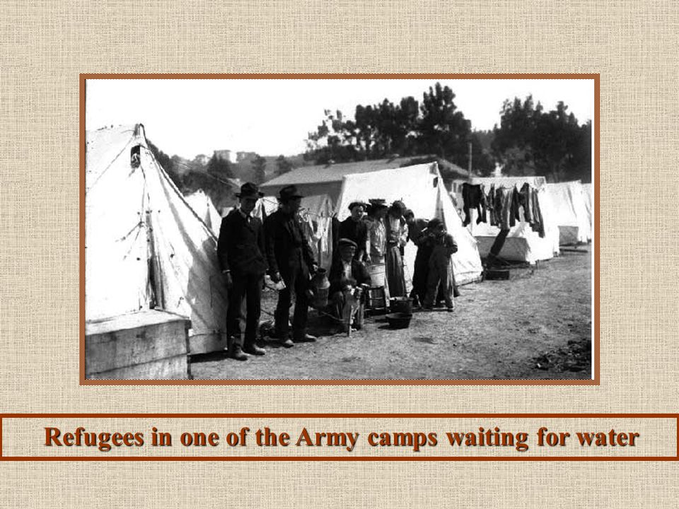 Refugees in one of the Army camps waiting for water