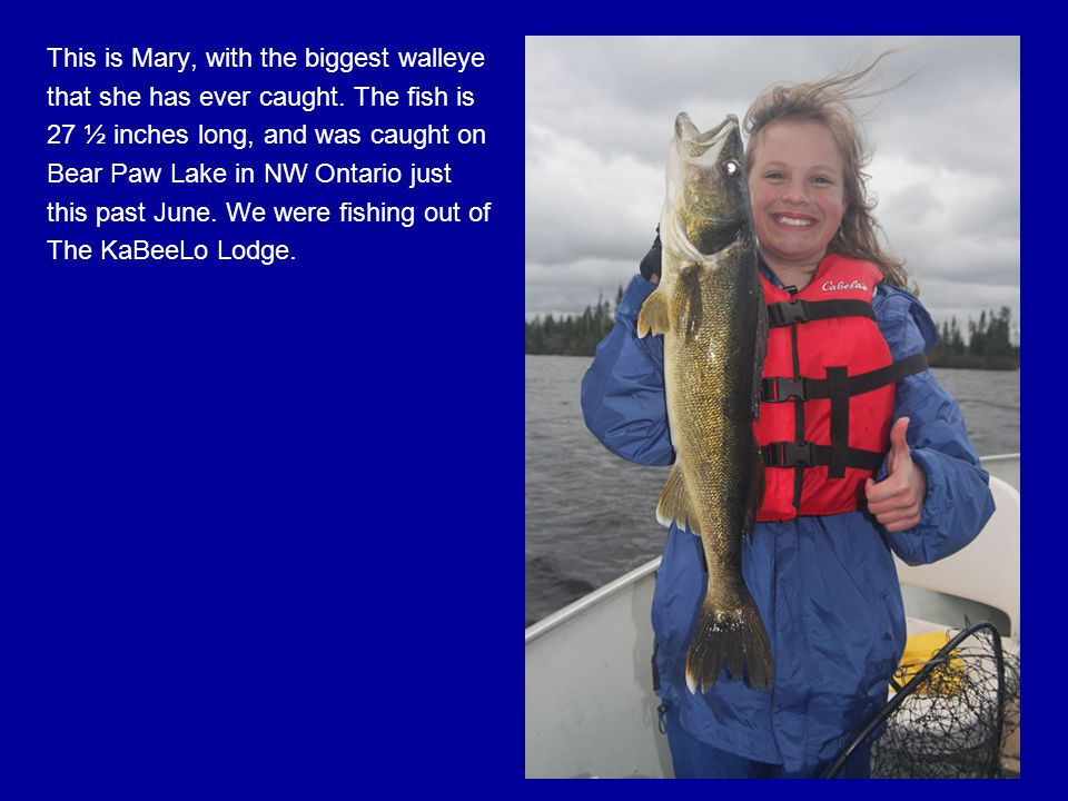 This is Mary, with the biggest walleye that she has ever caught.