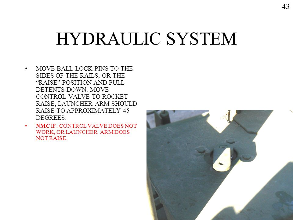 "HYDRAULIC SYSTEM MOVE BALL LOCK PINS TO THE SIDES OF THE RAILS, OR THE ""RAISE"" POSITION AND PULL DETENTS DOWN. MOVE CONTROL VALVE TO ROCKET RAISE, LAU"