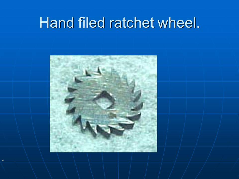 Hand filed ratchet wheel.