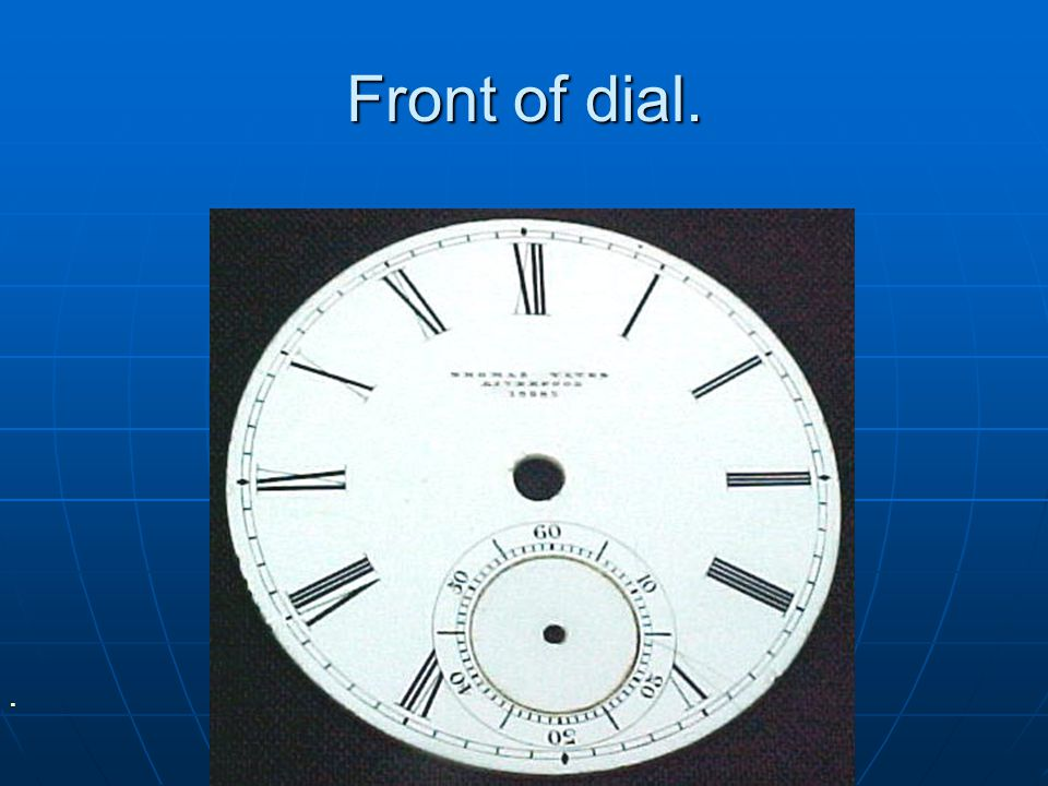 Front of dial.