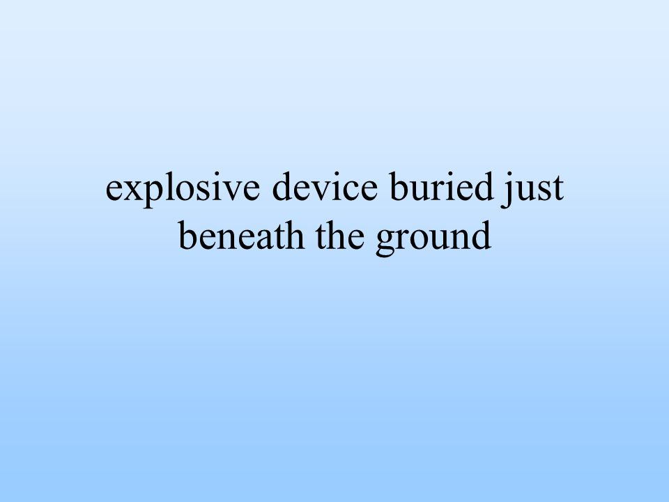 explosive device buried just beneath the ground
