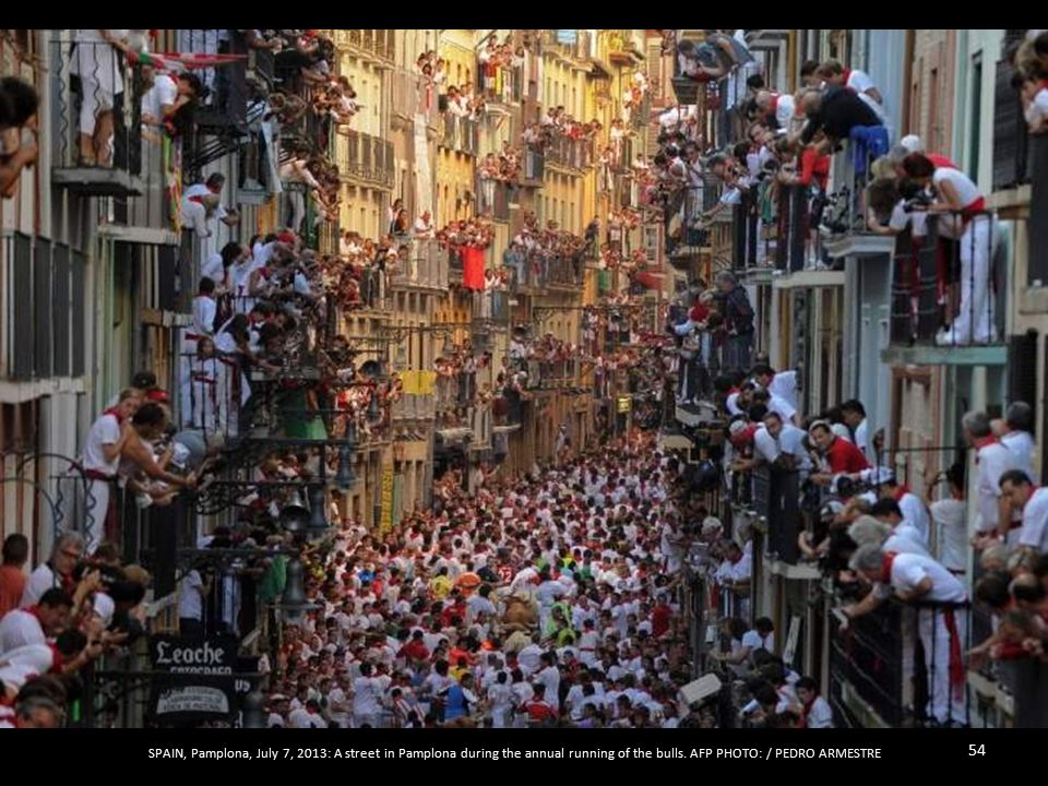 SPAIN, Denia, July 8, 2013: Participants run with the bulls