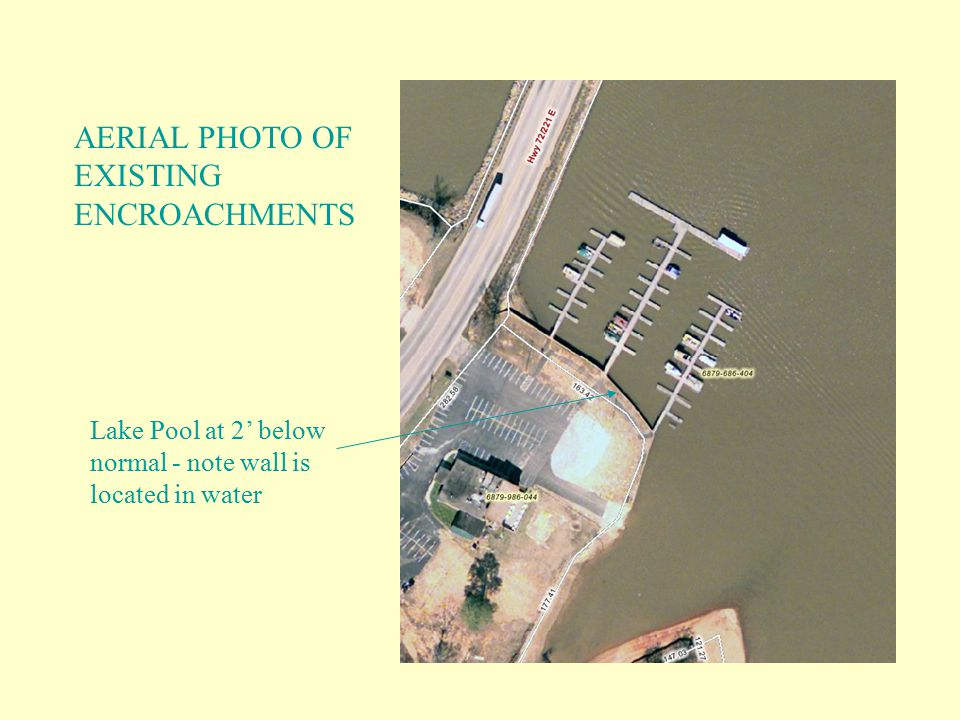AERIAL PHOTO OF EXISTING ENCROACHMENTS Lake Pool at 2' below normal - note wall is located in water