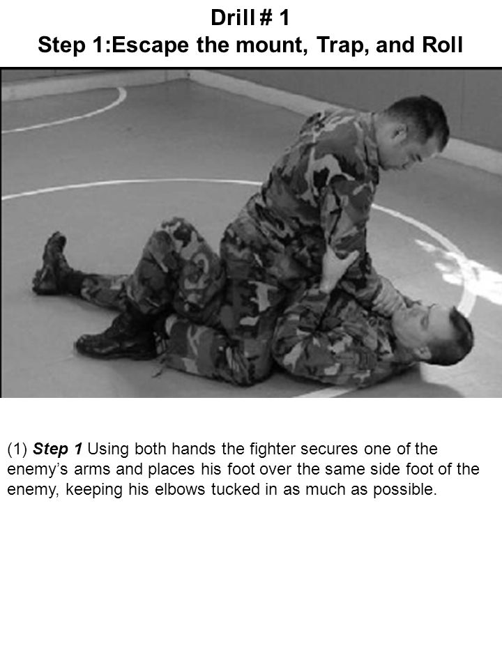 (1) Step 1 Using both hands the fighter secures one of the enemy's arms and places his foot over the same side foot of the enemy, keeping his elbows t