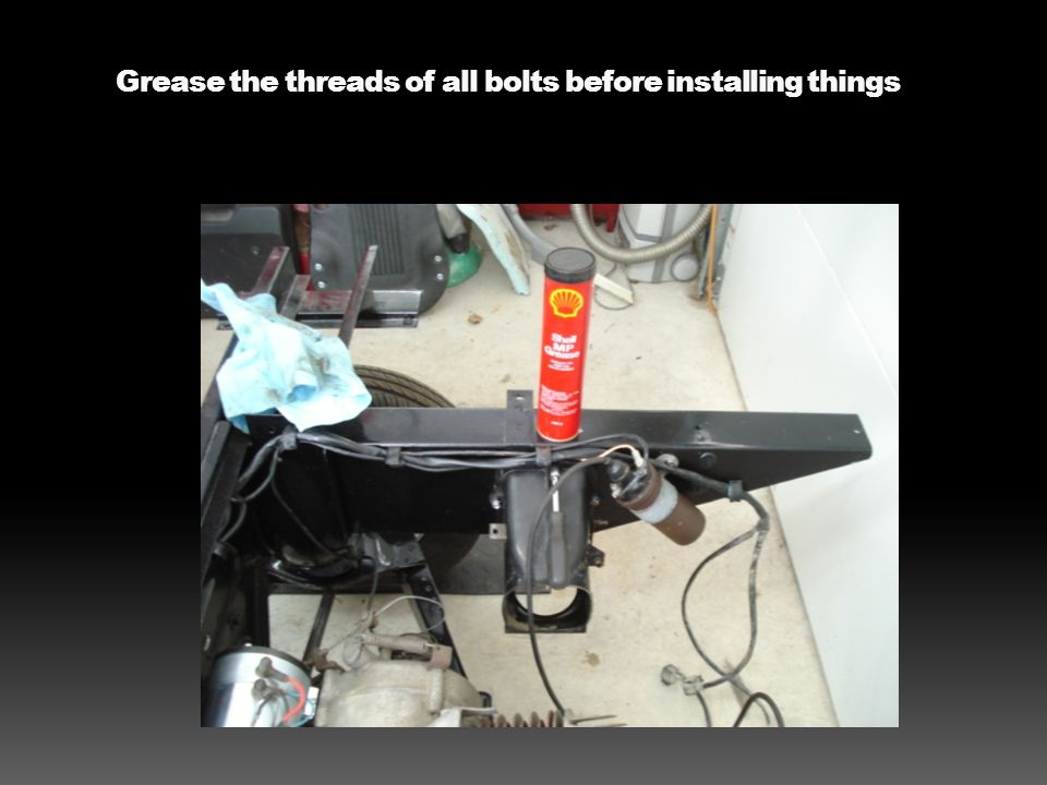 Mount the rubber holder for the reverse and clutch cables to hold them fast in place