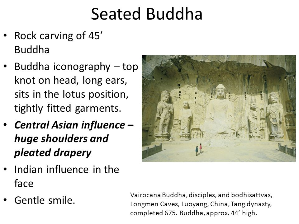 Seated Buddha Rock carving of 45' Buddha Buddha iconography – top knot on head, long ears, sits in the lotus position, tightly fitted garments. Centra