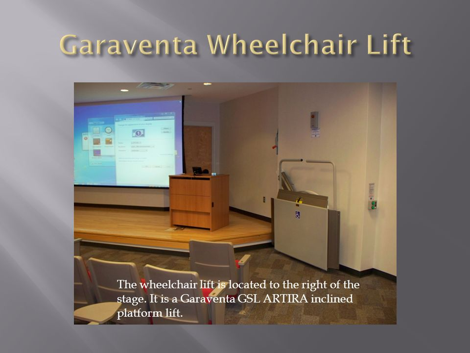 The wheelchair lift is located to the right of the stage. It is a Garaventa GSL ARTIRA inclined platform lift.
