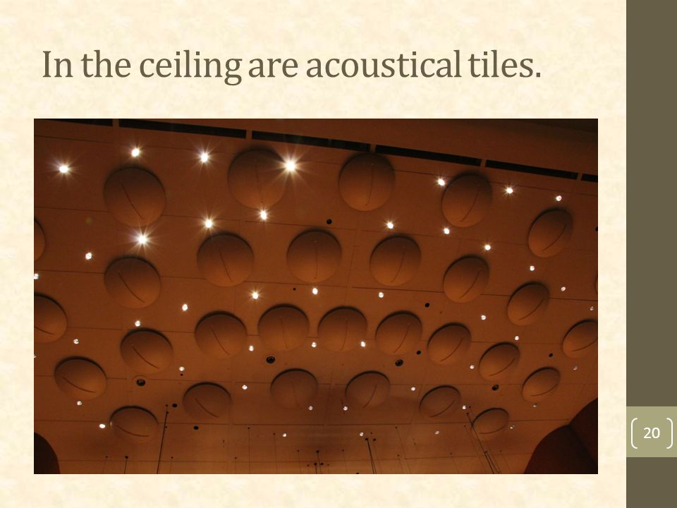 In the ceiling are acoustical tiles. 20