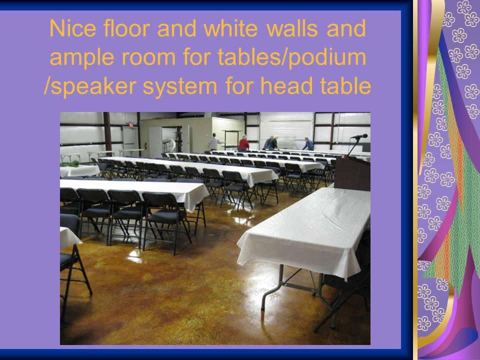Nice floor and white walls and ample room for tables/podium /speaker system for head table