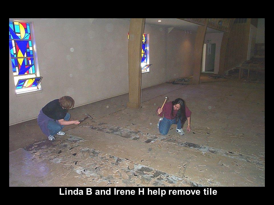 Linda B and Irene H help remove tile