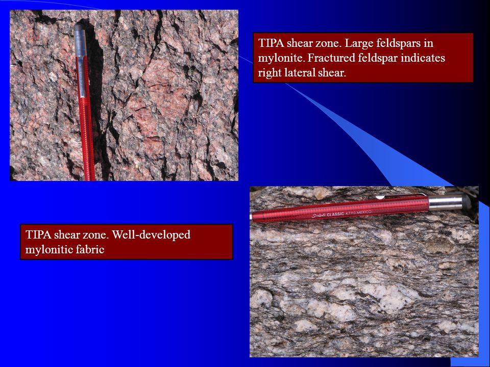TIPA shear zone. Large feldspars in mylonite. Fractured feldspar indicates right lateral shear. TIPA shear zone. Well-developed mylonitic fabric
