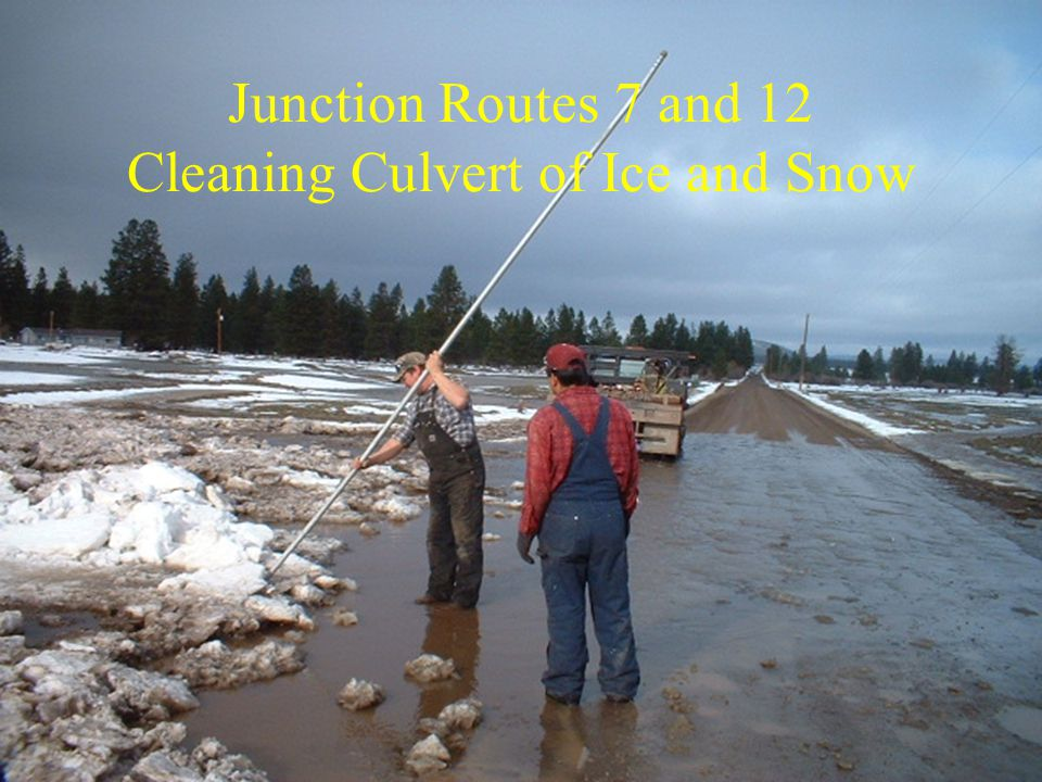Junction Routes 7 and 12 Cleaning Culvert of Ice and Snow