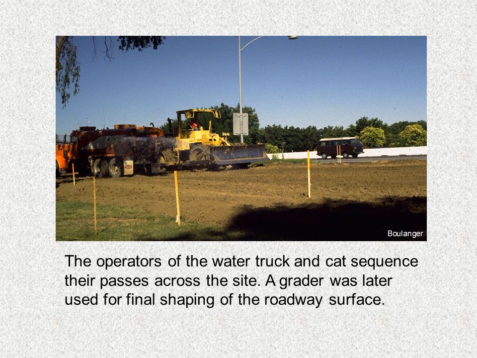 The operators of the water truck and cat sequence their passes across the site.