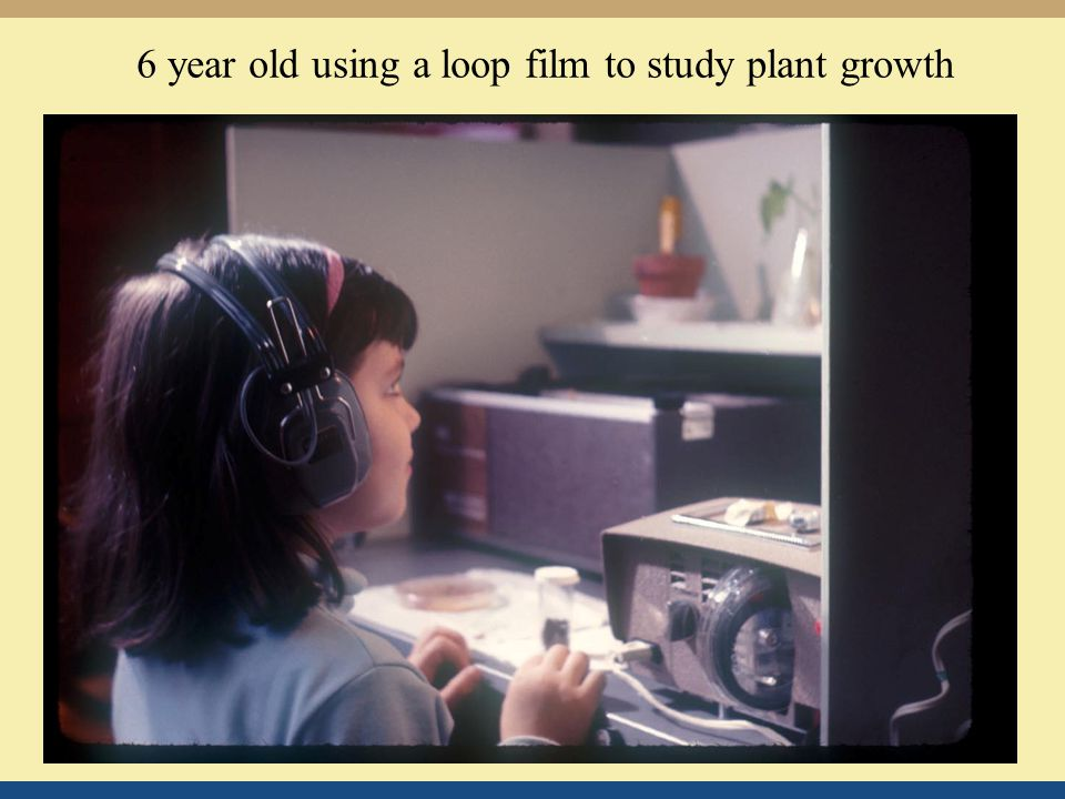6 year old using a loop film to study plant growth