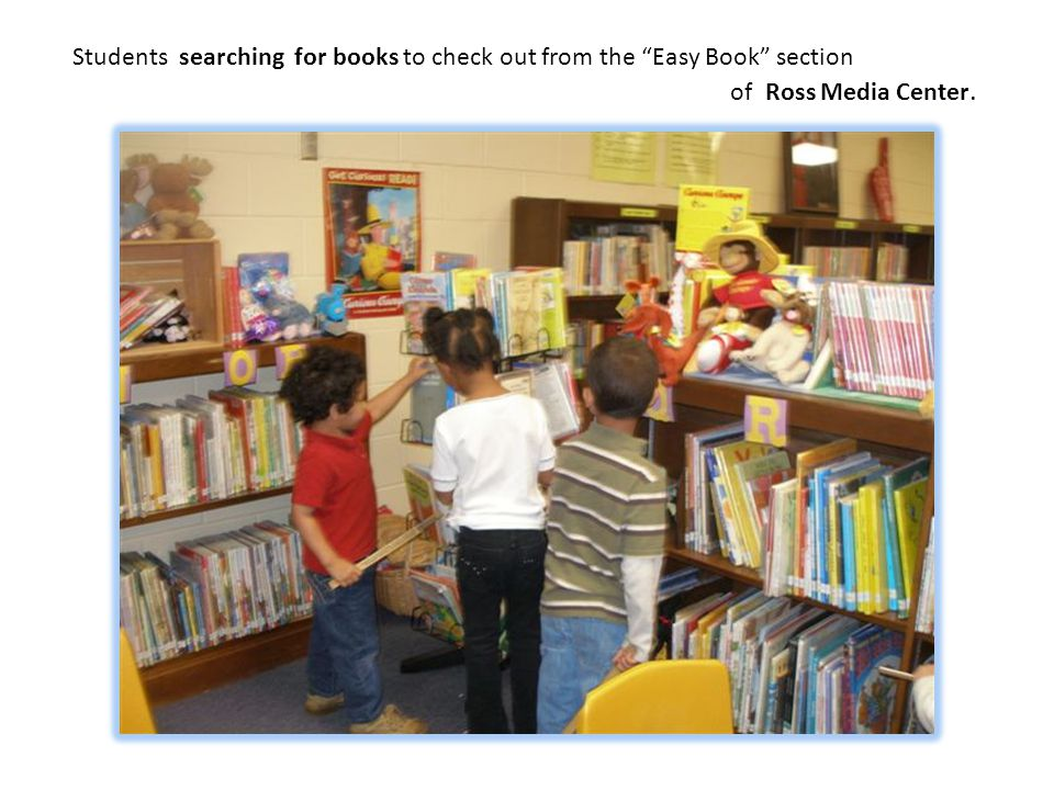 Students searching for books to check out from the Easy Book section of Ross Media Center.