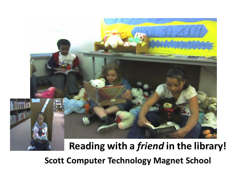 Reading with a friend in the library! Scott Computer Technology Magnet School
