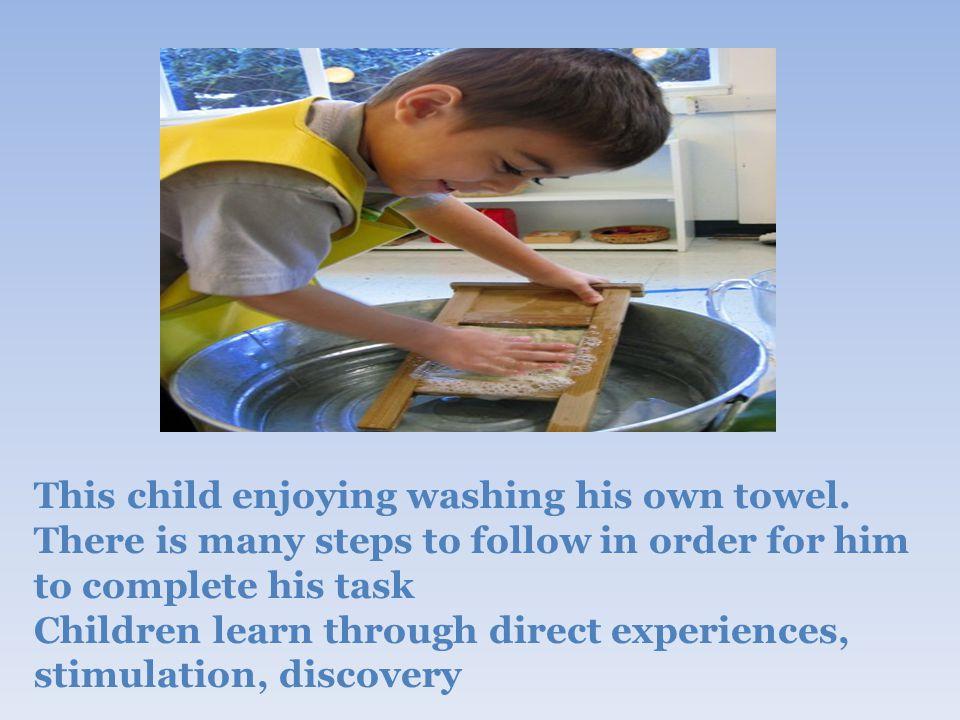 This child enjoying washing his own towel.