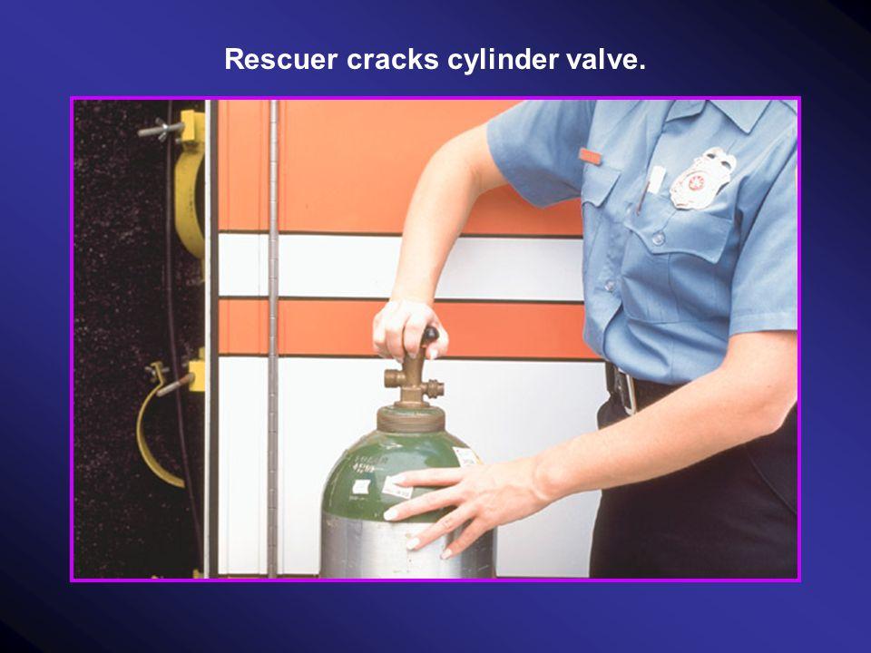 Rescuer cracks cylinder valve.