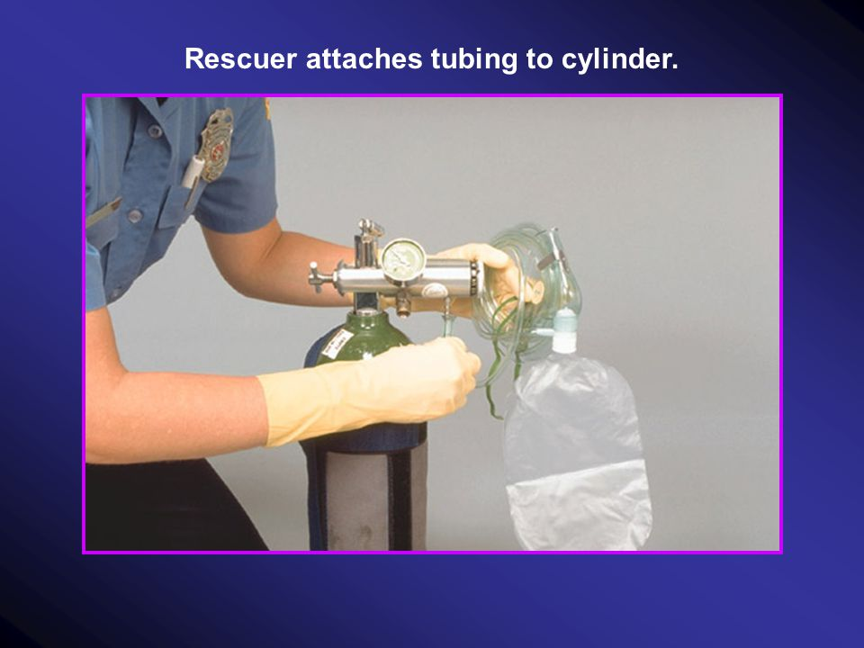 Rescuer attaches tubing to cylinder.